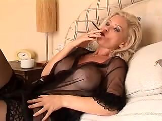 super-fucking-hot blonde Cougar Smoking Solo in Lingerie and stocking
