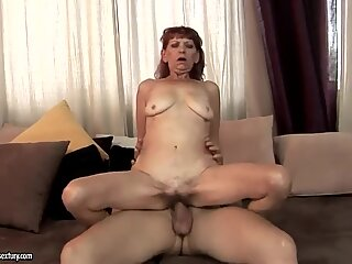 Nasty ginger granny Irene with disgusting swinging boobs is doing blowjob to her young tight dicked fucker friend.
