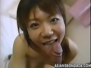 Japanese cutie moans while her hairy muff is drilled