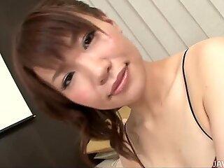 Divine brunette hoochie Kana Mimura gives a footjob